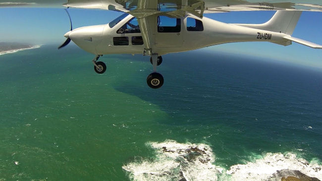 Jabiru J430 Flying over the Sea SA Garden Route